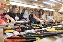 Students selecting food from salad bar